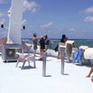 Guests relax on Taka's sun deck after diving the Great Barrier Reef