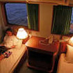 Standard twin bed cabin with reading lights and sunlight