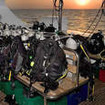 As the sun sets in Egypt, night dive preparations begin on Cassiopeia's dive deck