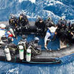 Lucky divers on the tender preparing for underwater adventure