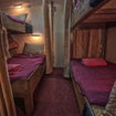 The Junk's Quad bed cabin with privacy curtains