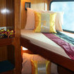 Standard bunk cabin with reading lights and sunlight