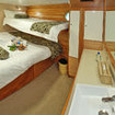Nai'a Standard twin/double bed cabin featuring a king bed and a single bunk