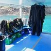 Equipment and wetsuits on the dive deck