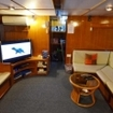The indoor saloon of the Thailand liveaboard Andaman Tritan