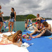 Enjoy the warm sundeck and meet new friends on dive day tours in Phuket