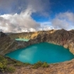 At the viewpoint, steaming volcanic colourful lakes in Kelimutu craters, Flores