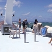 Guests relax on a sun deck after diving the Great Barrier Reef