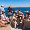 Sharing happy moments with new friends on the sun deck of a liveaboard in Australia
