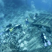 Divers exploring the remains of the Yolanda wreck at Ras Mohammed