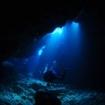 A scuba diver explore the caverns of Koh Ha, Thailand