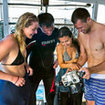 Divemasters socialise with and advise their scuba divers