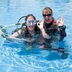 An Open Water Diver student enjoying her pool lesson