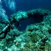 A crack in the reef invites divers down a wall in Banda