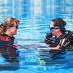 PADI Open Water Diver student llistening to her instructor
