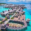 Paradise chalets over azure shallows at Mabul Water Bungalows