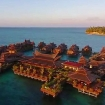 The sun sets over Mabul Water Bungalows