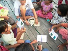 Helen Brunt handing out information packs to local children - photo courtesy of Dr. Elizabeth Wood
